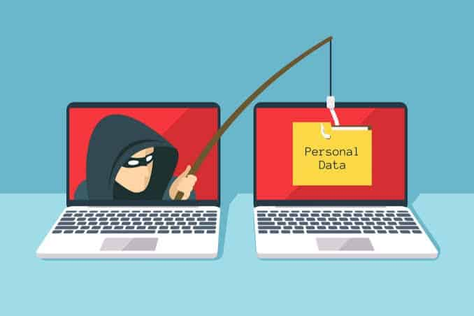 image hsowing two laptops and one has a hacker using a fishing rod to collect data from the other as he is phishing and this is how ransomware gets on your computer